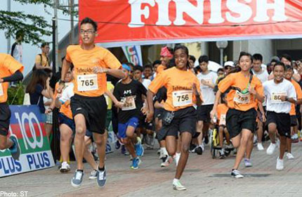 Students put best foot forward for charity run