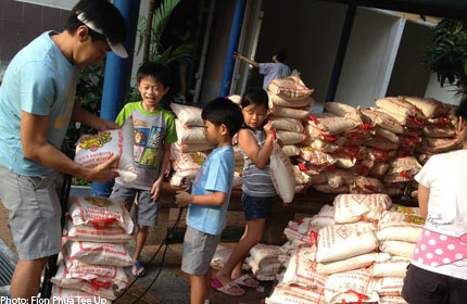 Woman gives up $70k in branded bags for 32 tonnes of rice